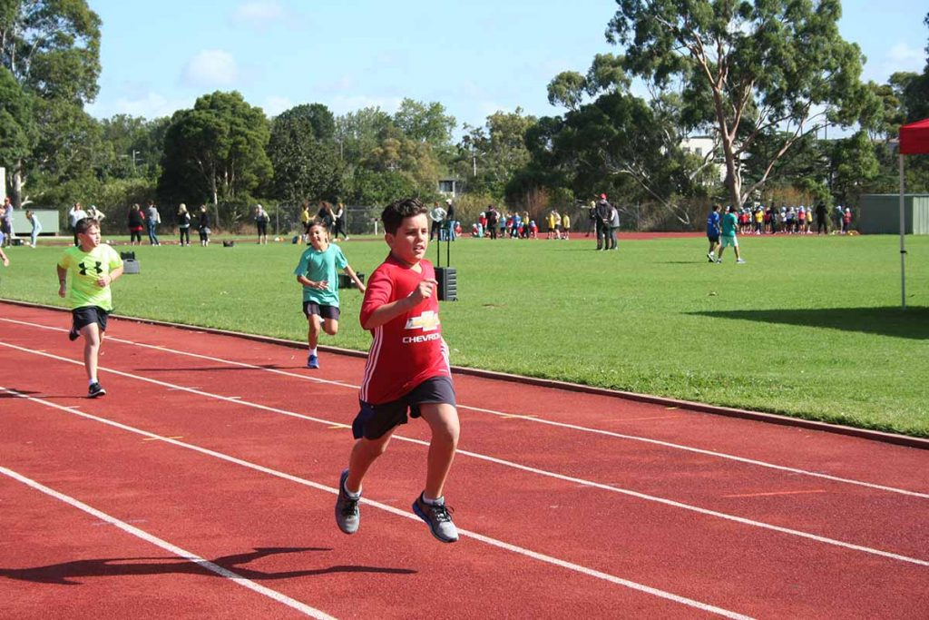 Sports Day - child running on track